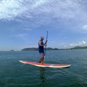 Person at the stand up paddle board tour