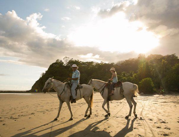 Little girl at the horseback riding tour