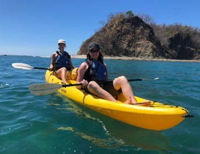 Two women kayaking at Samara's sea